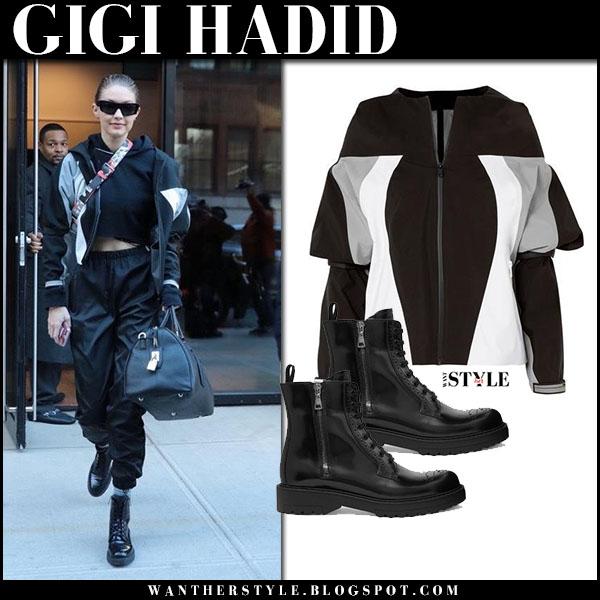 Gigi Hadid in black color-block prada jacket, black track pants and boots prada model street style january 24