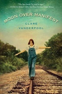 Cover of Moon over Manifest, girl in overalls balancing on a train rail