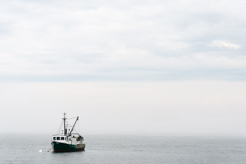 Portland, Maine USA July 2017 photo by Corey Templeton. The fishing vessel E Cosi II floating in the fog somewhere in Portland Harbor.