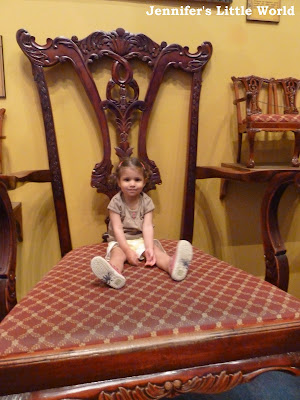 Child sitting on an enormous chair