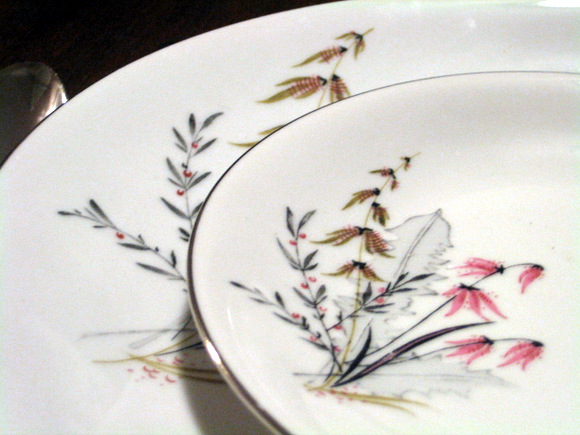 This piece is so fun--I love the whimsical floral pattern on this china.
