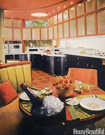 This 60s style kitchen with unique cabinets and a circular table is retro.