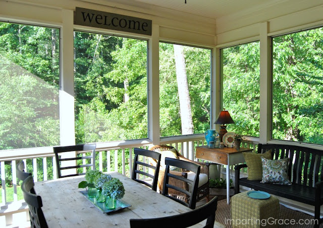 Cool and shaded screened porch with eating and sitting area