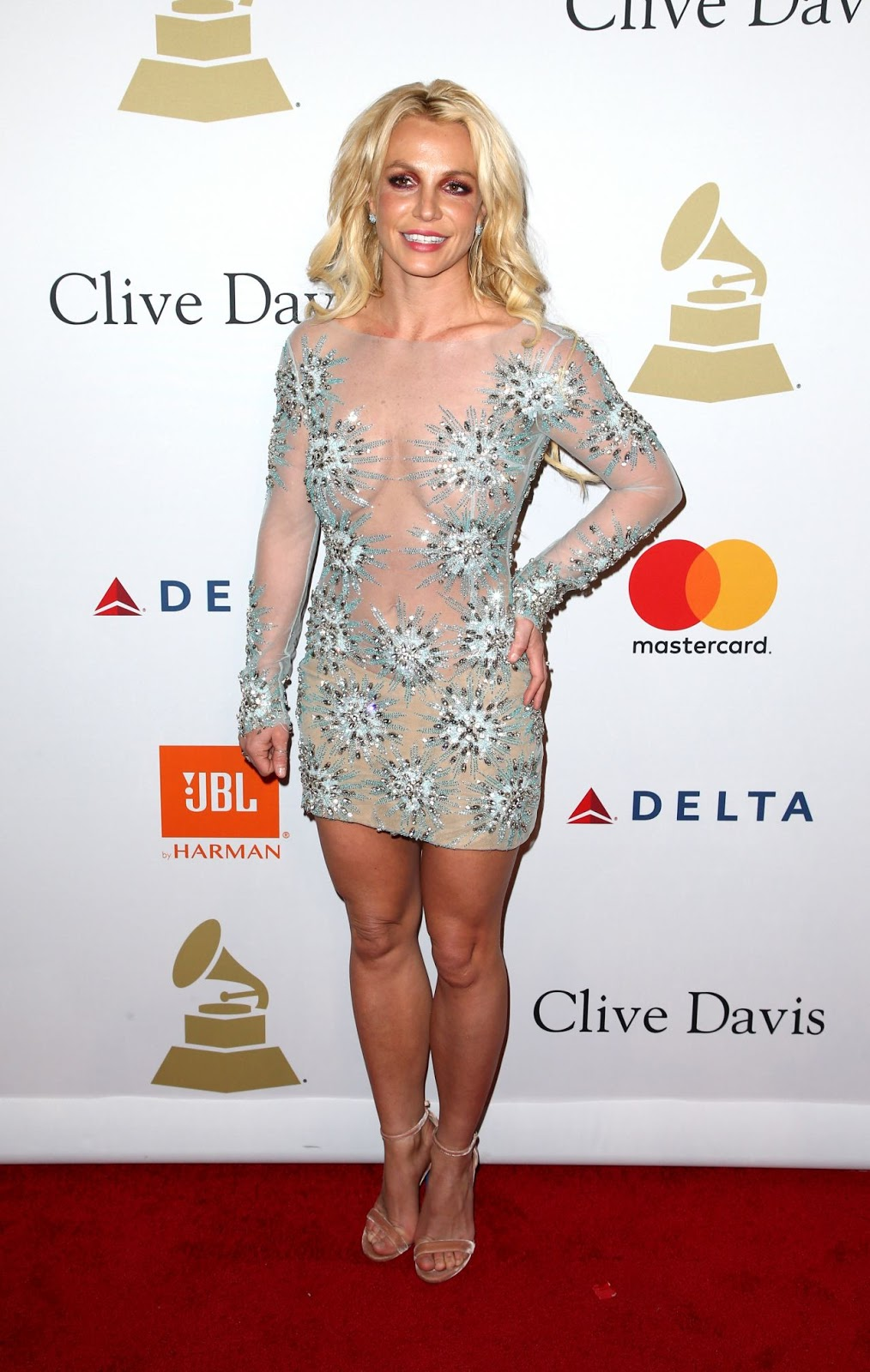 Britney Spears bares cleavage in sheer mini dress at the Clive Davis Pre-Grammy party in LA