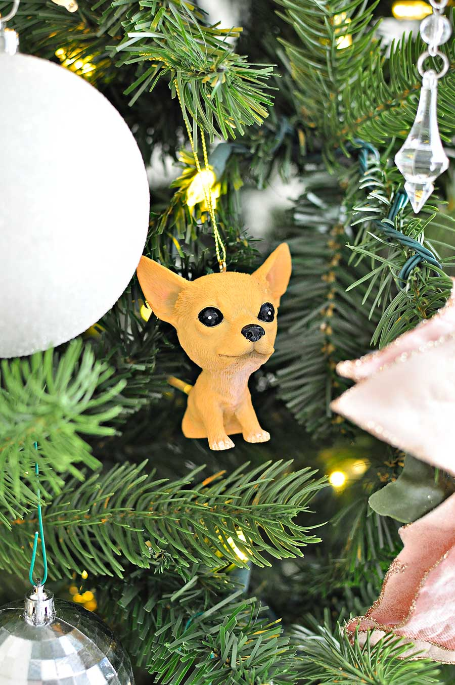A cute chihuahua dog ornament is a way to incorporate the family pet into holiday decor traditions.
