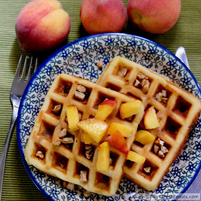 image of peach and pecan waffles topped with fresh peaches and pecans