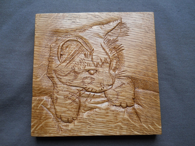 wood carving of a kitten