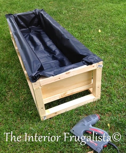 Lining water trough with pond liner on DIY Outdoor Water Wall