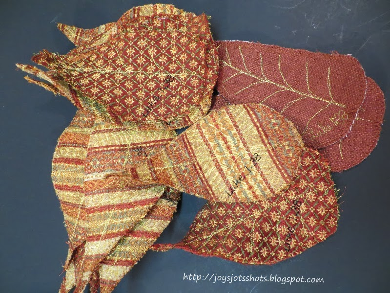 http://joysjotsshots.blogspot.com/2013/10/fall-fabric-leaves-leaf-coasters.html