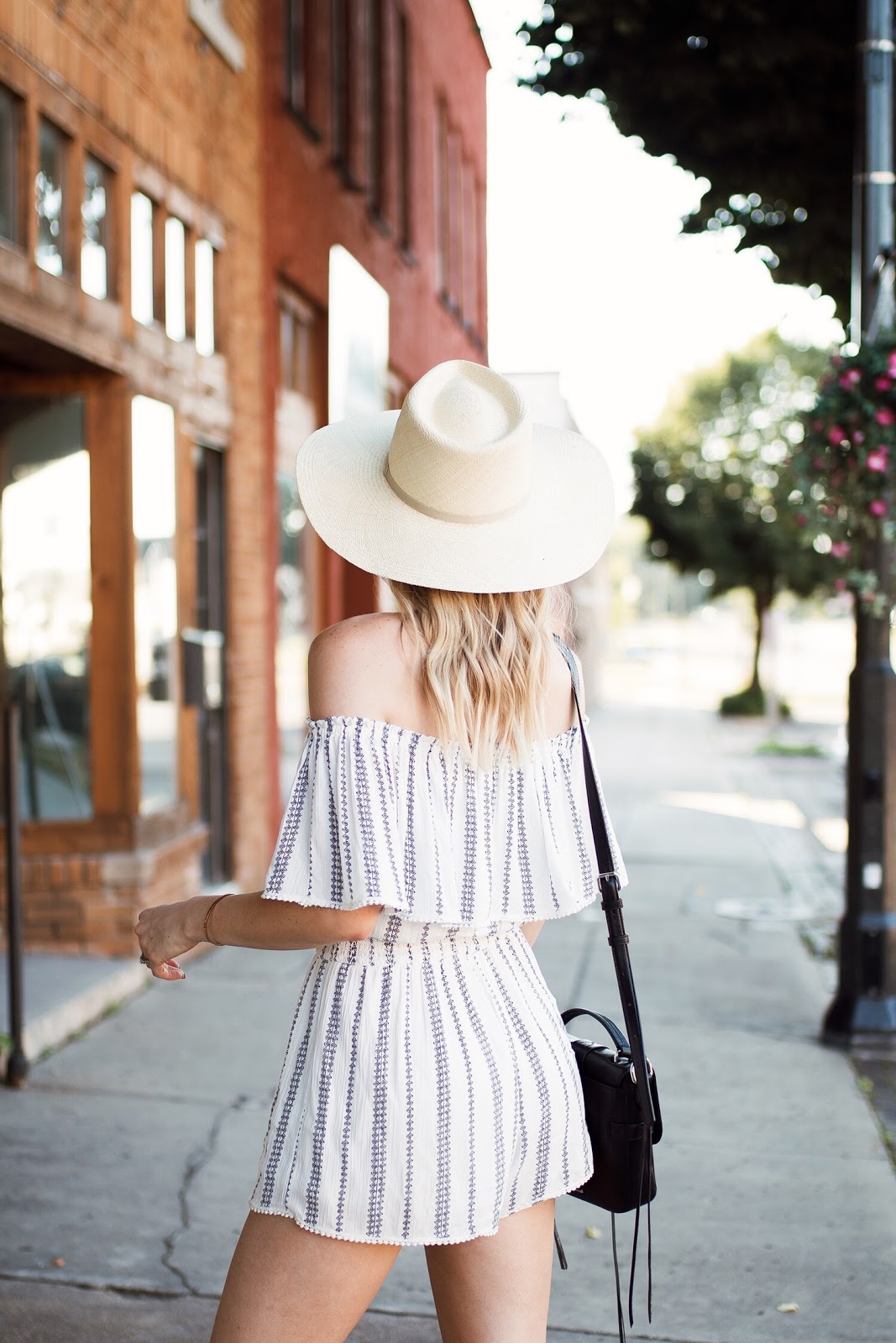 striped off-the-shoulder romper + a wide brim hat