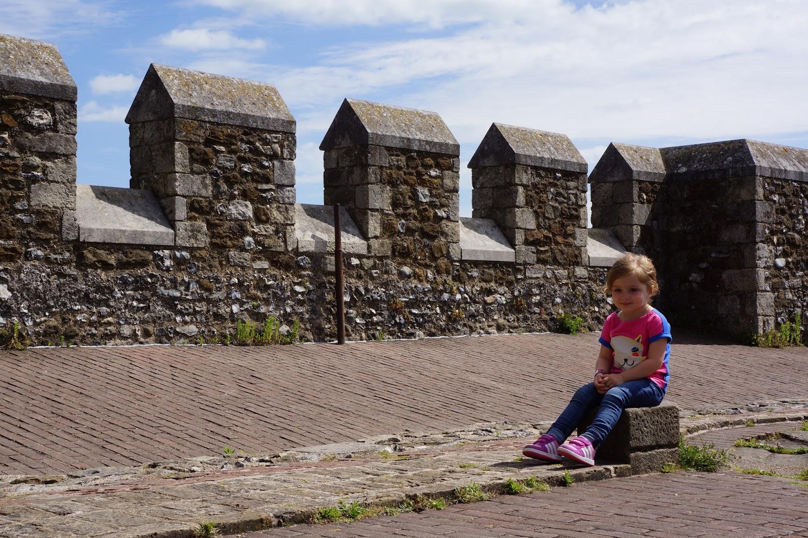 child sitting at dover castle tower floor