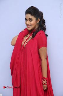 Actress Poorna Latest Stills in Red Dress at Rakshasi First Look Launch  0041.JPG