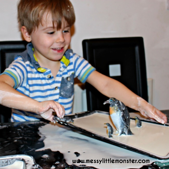 oobleck sensory play ideas for kids. A frozen small world with a penguin and winter theme.