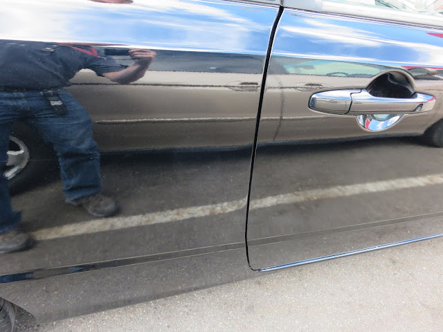 Honda Civic with dented door and quarter panel after auto body repairs.