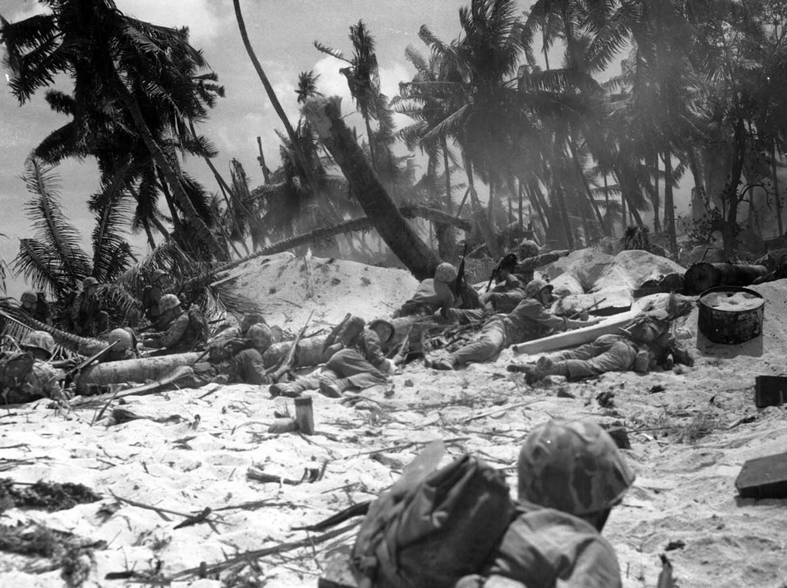 U.S. Marines are seen as they advance against Japanese positions during the invasion at Tarawa atoll, Gilbert Islands, in this late November 1943 photo. Of the nearly 5,000 Japanese soldiers and workers on the island, only 146 were captured, the rest were killed.