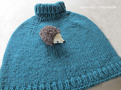 gestrickter Cape Pullover in petrol
