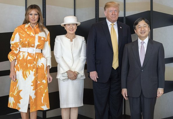 Melania Trump wore Dries van Noten floral print cotton coat. Naruhito and Empress Masako at Tokyo hotel