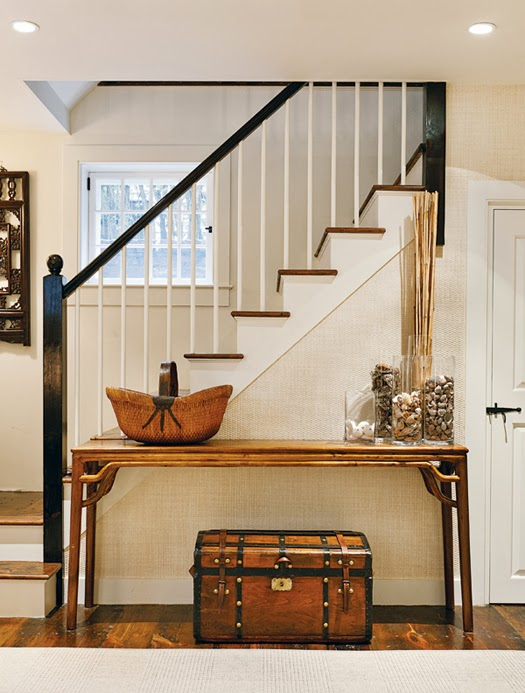 entryway w/ antique table + trunk