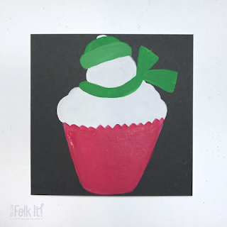 Snowman topped cupcake - with painted areas of red (the cupcake wrapper) and green (for the Snowmans hat and scarf)