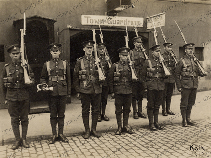 Young Soldiers, 52nd Battalion, Durham Light Infantry, mounting guard at a sentry post outside the town guardroom, Cologne, Germany, 1919, Private Thomas Brown, front row, extreme right (D/DLI 7/839/11)