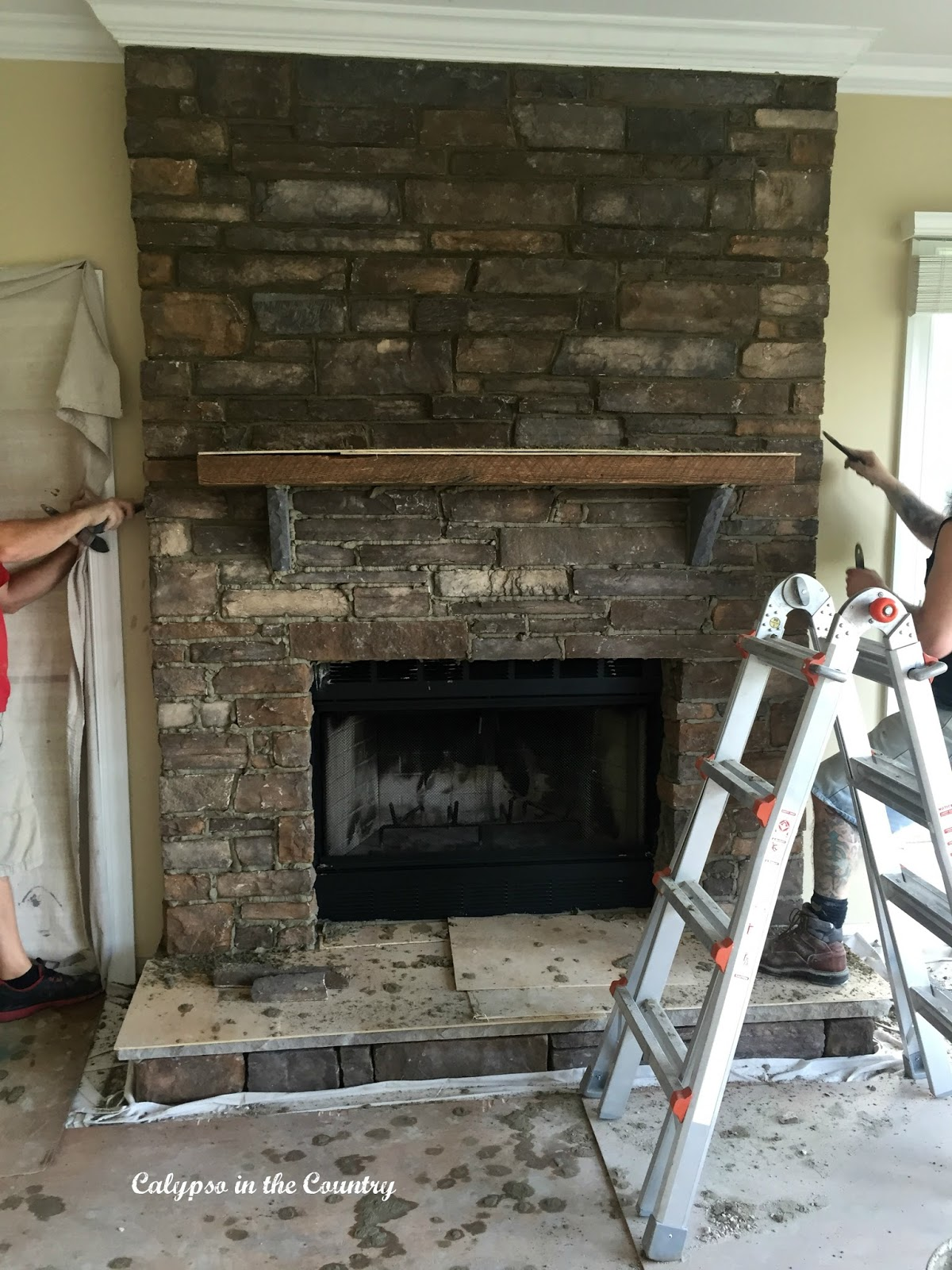 Before and after rustic stone fireplace