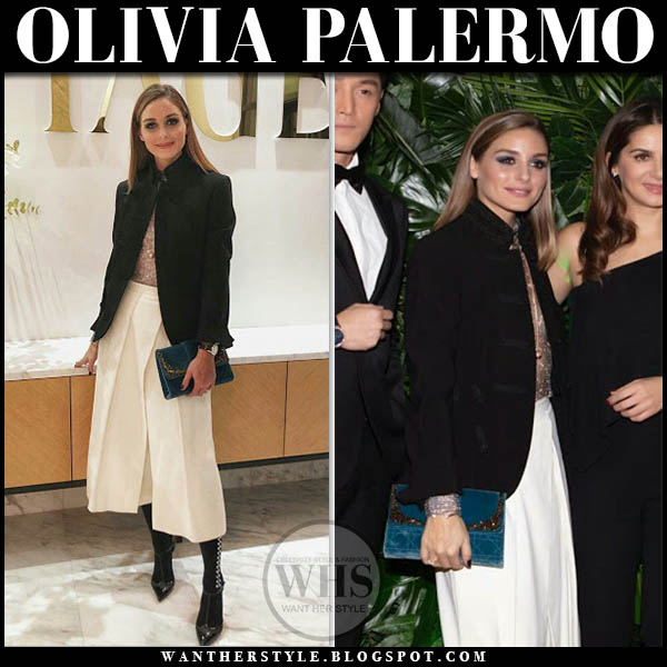 Olivia Palermo in black jacket, white cropped pants with blue velvet dior clutch celebrity style january 15