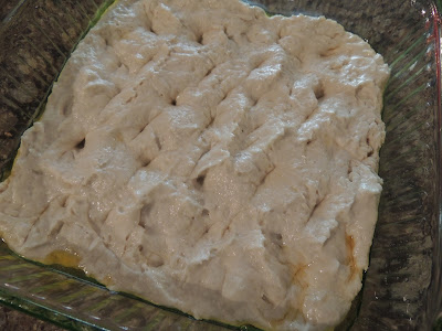 poking holes in the focaccia dough