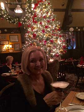 Palmia Observatory Resident Astronomer Peggy toasts the holidy season at Gulliver's Restaurant