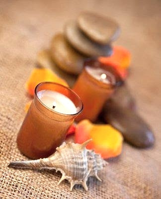 fall centerpiece with candles and beach finds