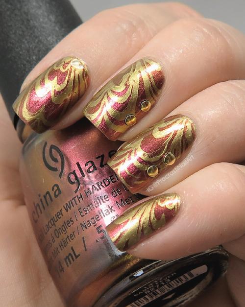 Watermarble stamping nail art