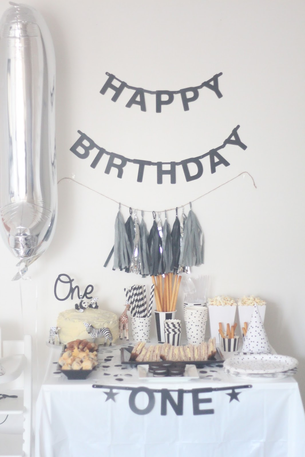 A monochrome first birthday party oh so amelia for 1st birthday party decoration for boys