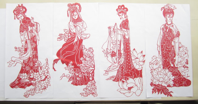 a paper-cutting of the 4 most beauties of ancient China