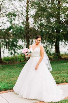 bride in wedding dress and pink bouquet