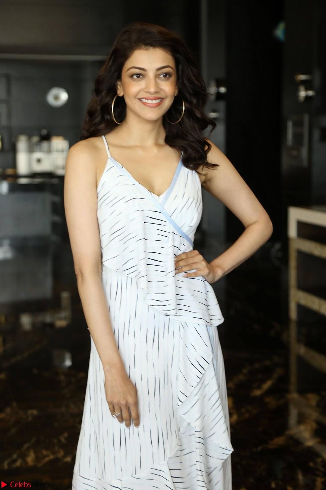 Kajal Aggarwal sizzles in Black Deep Neck Dress ~  Exclusive 002.jpg
