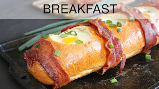 Image of loaf of bread with eggs baked in, a recipe index link to Breakfast page.