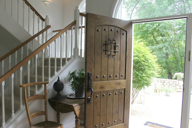 Rustic alder door in entry with French prayer chair - Hello Lovely Studio