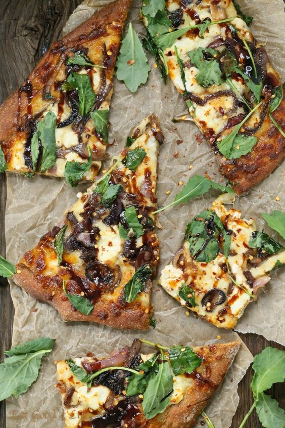 Eat Good 4 Life caramelized onion kale goat cheese pizza with balsamic drizzle. This is made with whole wheat pizza dough.