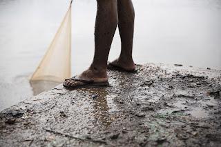 Homem pescando Princípio da Bagatela ou Insignificância no Direito Ambiental