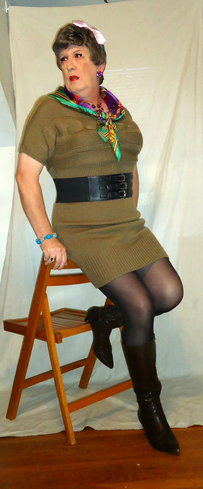 97e1635e464 The brown sweater dress is from Kmart s Attention line
