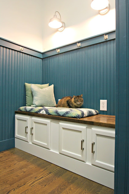 Mudroom bench made out of kitchen cabinets