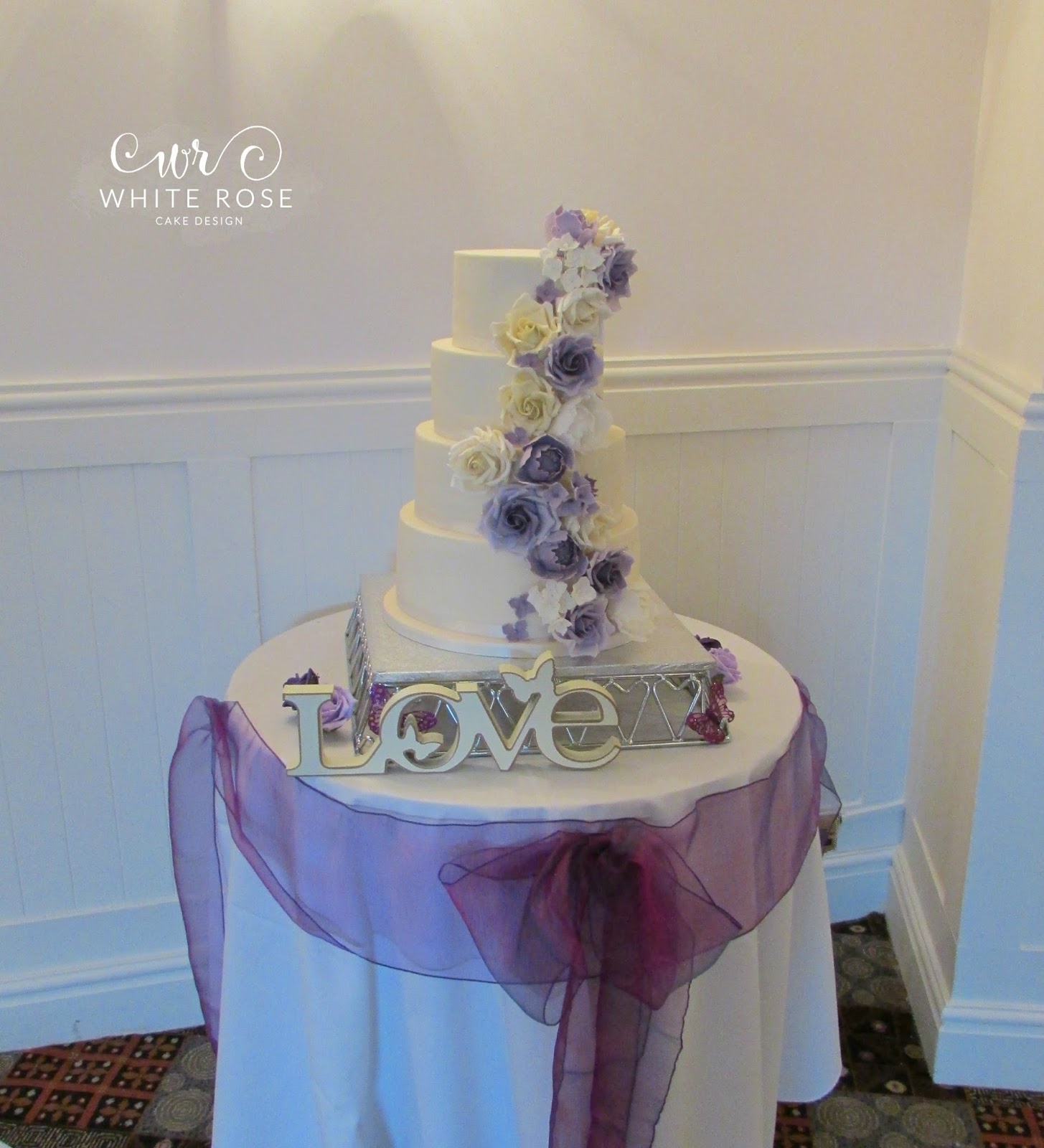 Lucy Had Asked For A Cascade Of Sugar Flowers Tumbling Down Her Cake In Shades Purple Lilac Whites And Ivories So This Is What We Came Up With