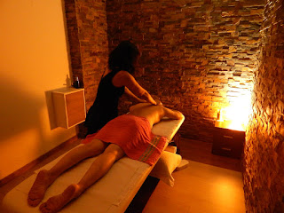 Nuna asian masseuse massaging shoulders in massage center Hâi, La Malagueta, Malaga