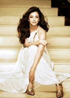 Aishwarya Rai Sitting On Stairs In White Dress