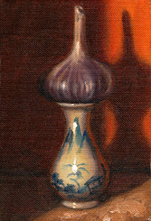 Oil painting of a garlic bulb on top of a small blue and white porcelain vase.