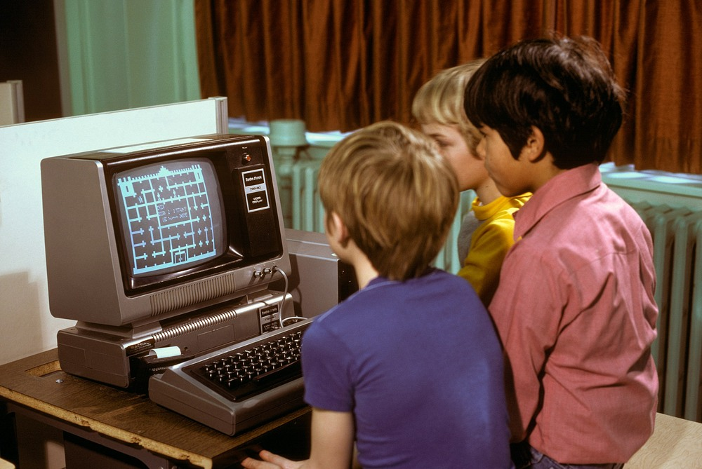 kids playing on a trs-80 computer