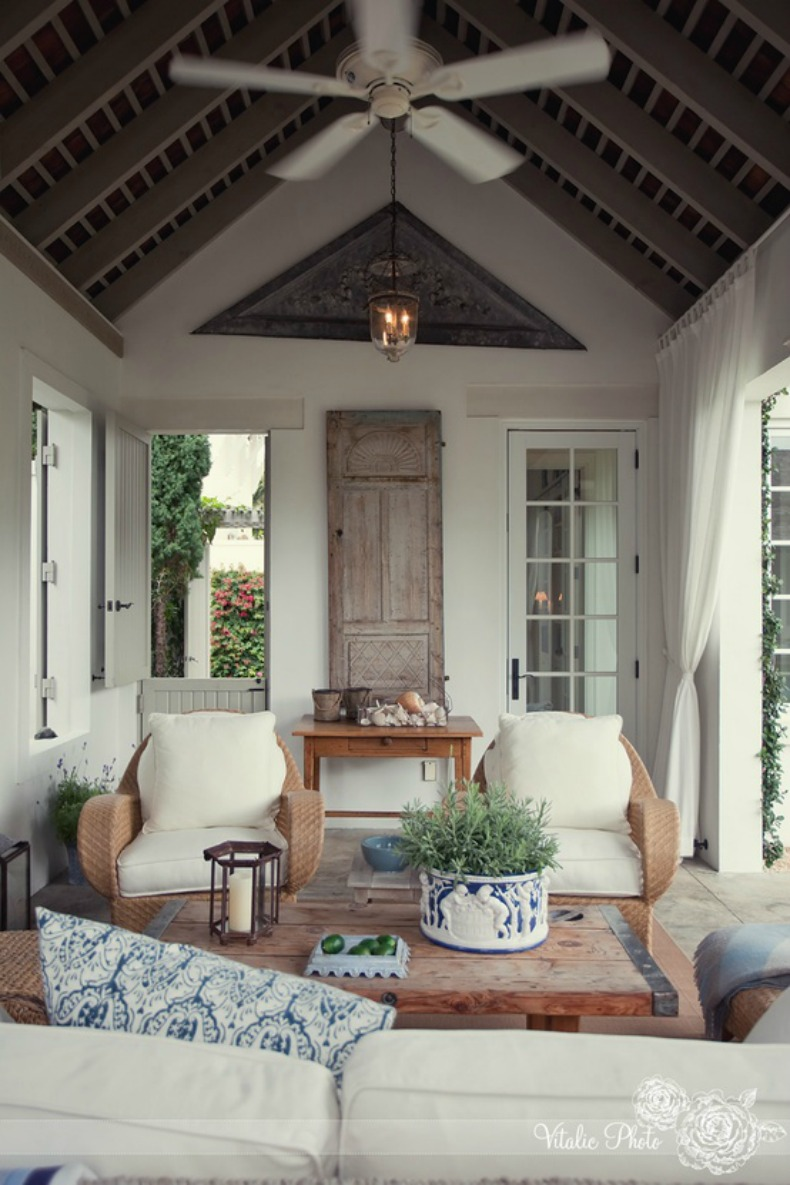 Weathered gray beams mixed with natural woods and blue and white accents, coastal outdoor living space.