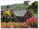 Greystone between the river and the mountains
