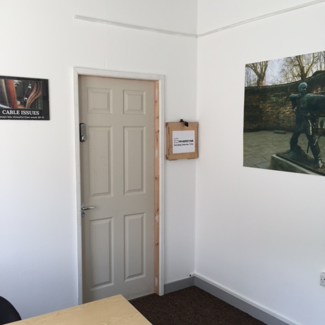 Cryptology Nottingham Review | Morgan's Milieu: An office, a picture of Robin Hood on the wall.