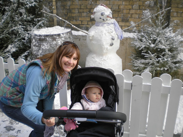 Tin Box Tot and Traveller with a fake snowman during their first visit