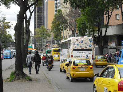 The soon to be illegal ass-and-cart struggles for position on a Bogotá street